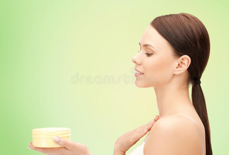Beautiful woman with moisturizing cream stock photo