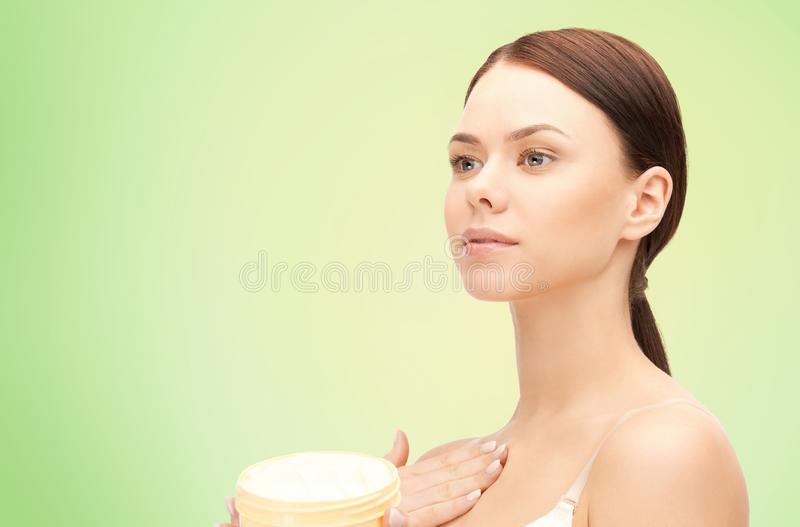 Beautiful woman with moisturizing cream stock photos