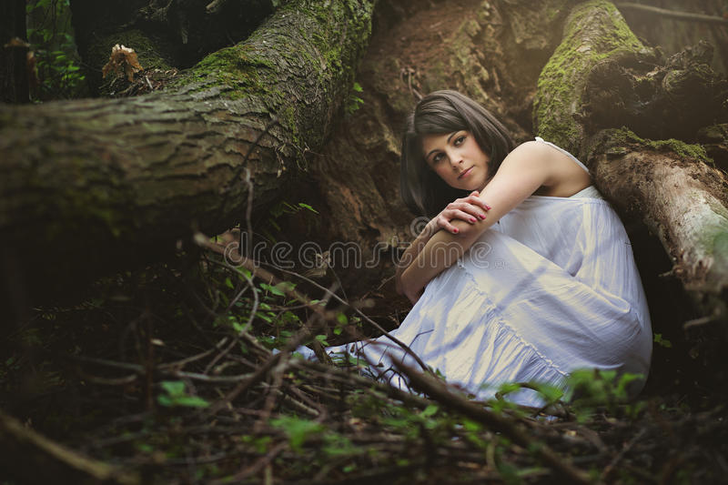 Beautiful woman in mother nature cradle royalty free stock images