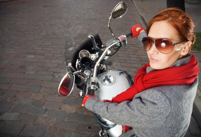 Beautiful woman on the motorcycle stock photography