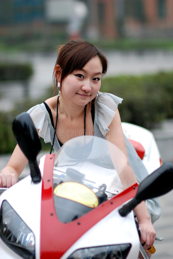 Beautiful woman on Motorcycle royalty free stock photo