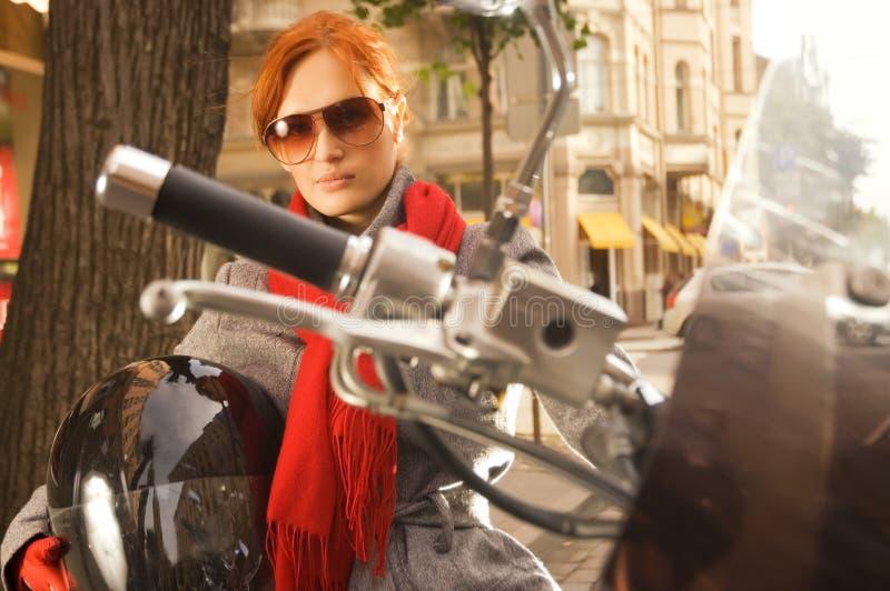 Beautiful woman on the motorcycle stock photo