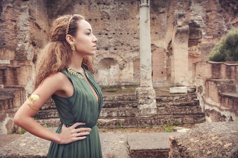 Beautiful woman near ancient ruins royalty free stock photo