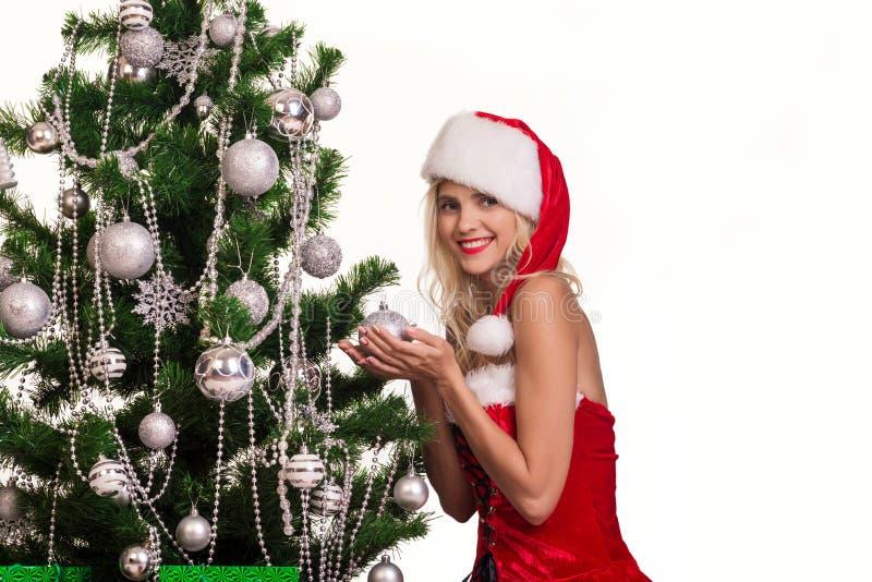 Beautiful woman near the New year tree stock image