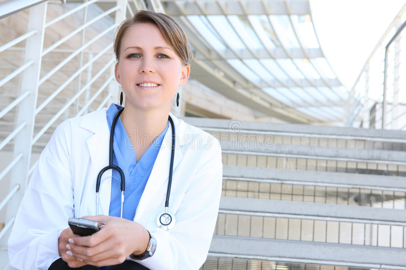 Beautiful Woman Nurse at Hospital on Stairs royalty free stock image