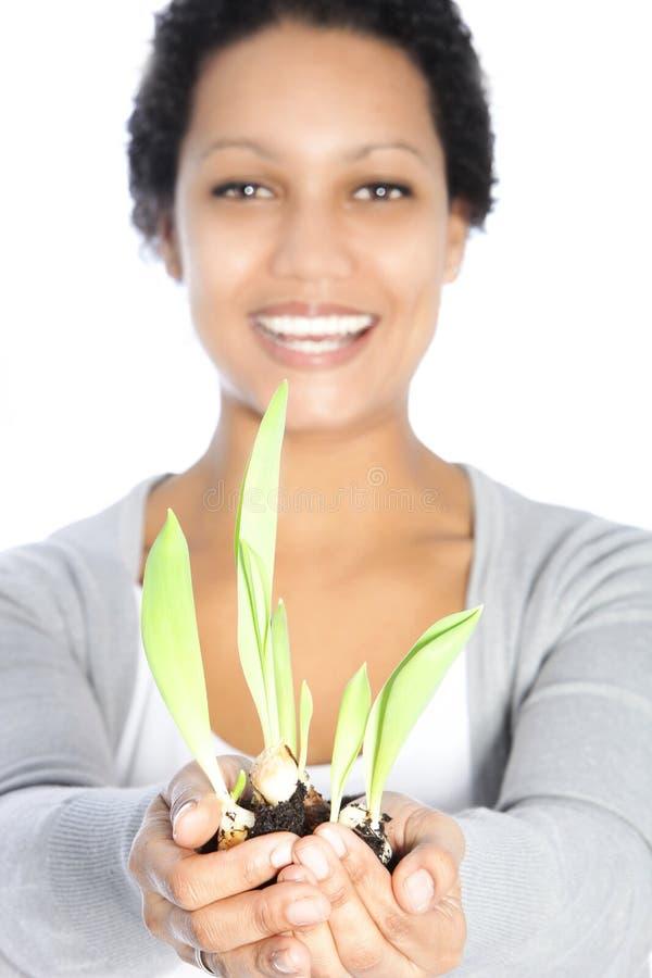 Free Beautiful Woman Nurturing A Spring Bulb Royalty Free Stock Photos - 30442688