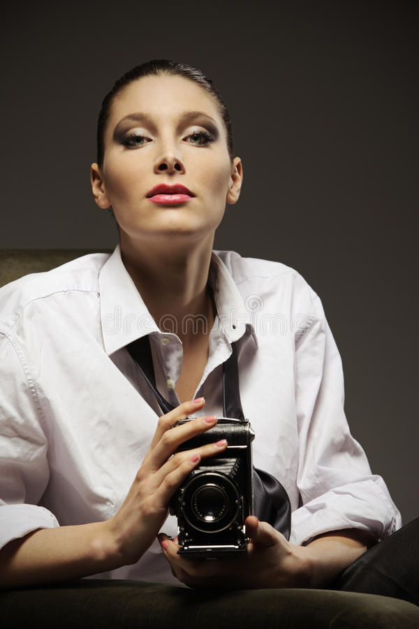 Beautiful woman with old camera royalty free stock photography