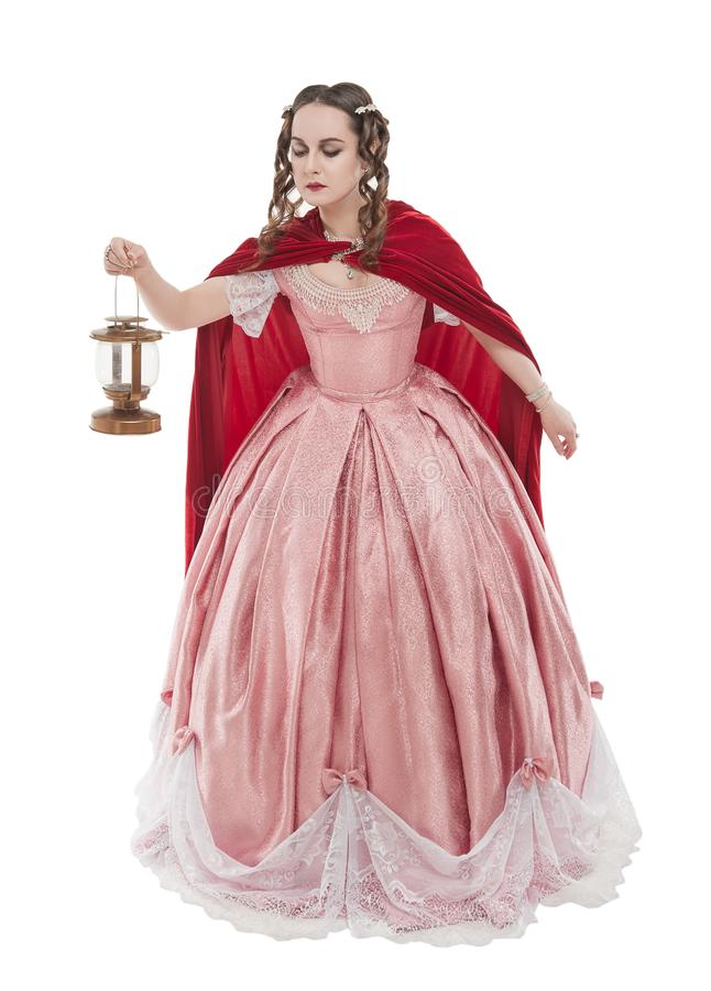 Beautiful woman in old historic medieval dress with lantern isolated royalty free stock images