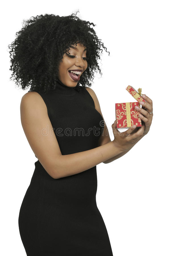 Beautiful woman opening a present royalty free stock photo