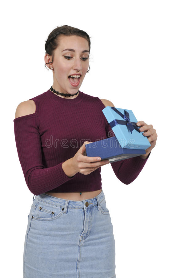Beautiful woman opening a present royalty free stock photo
