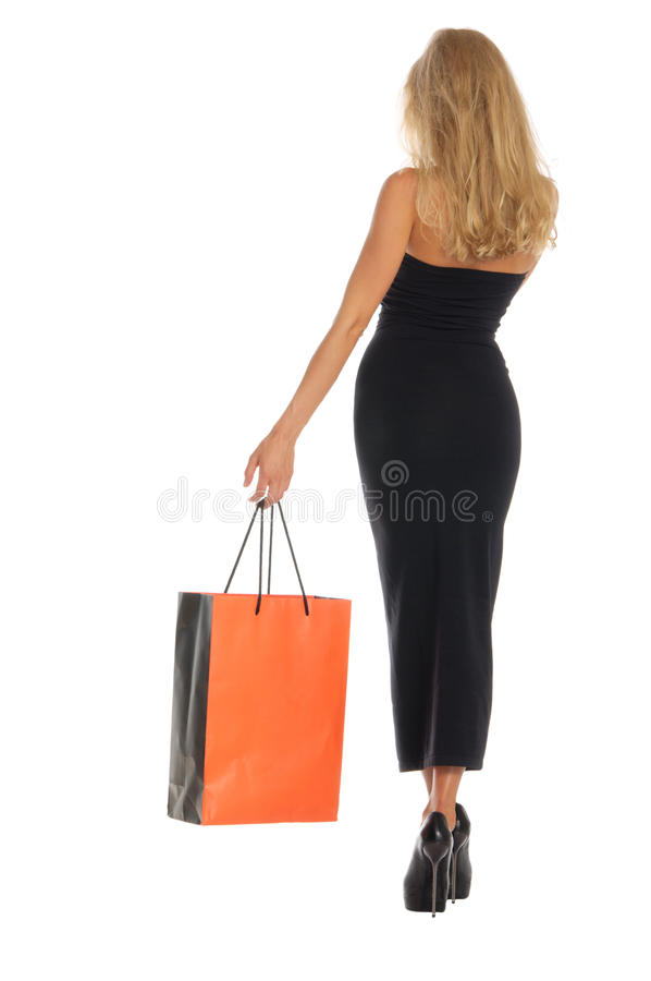 Beautiful woman with orange shopping bags royalty free stock photos