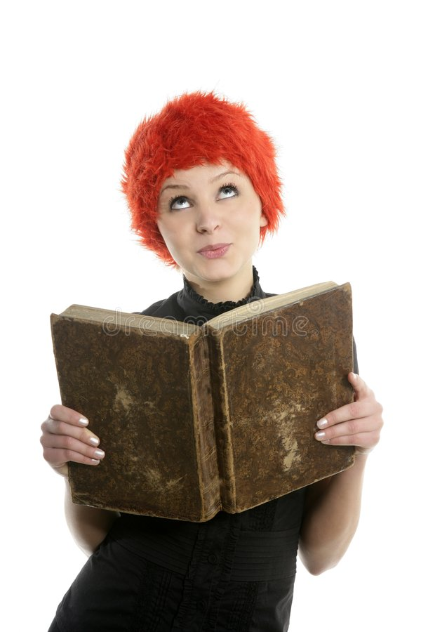 Beautiful woman, orange wig reading old book stock images