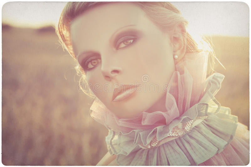 Beautiful woman outdoor portrait. Background on old, yellowed paper stock photo