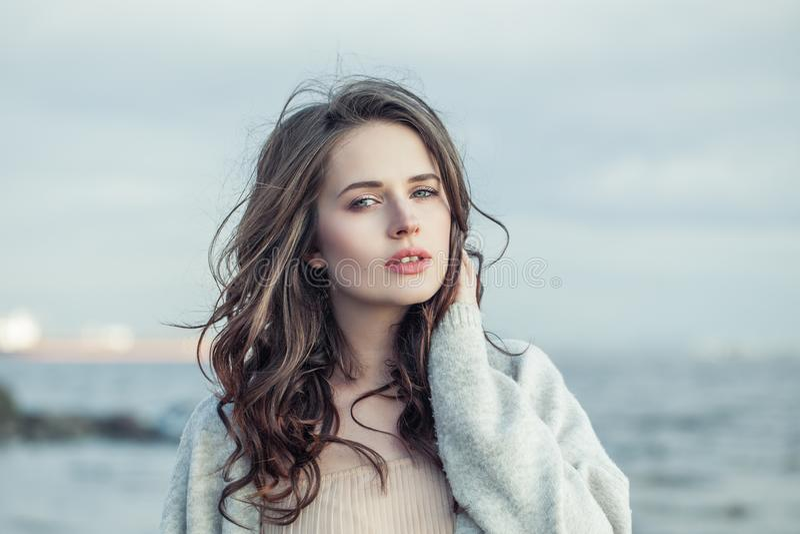 Beautiful woman outdoors portrait. Nice girl relaxing outdoor stock image