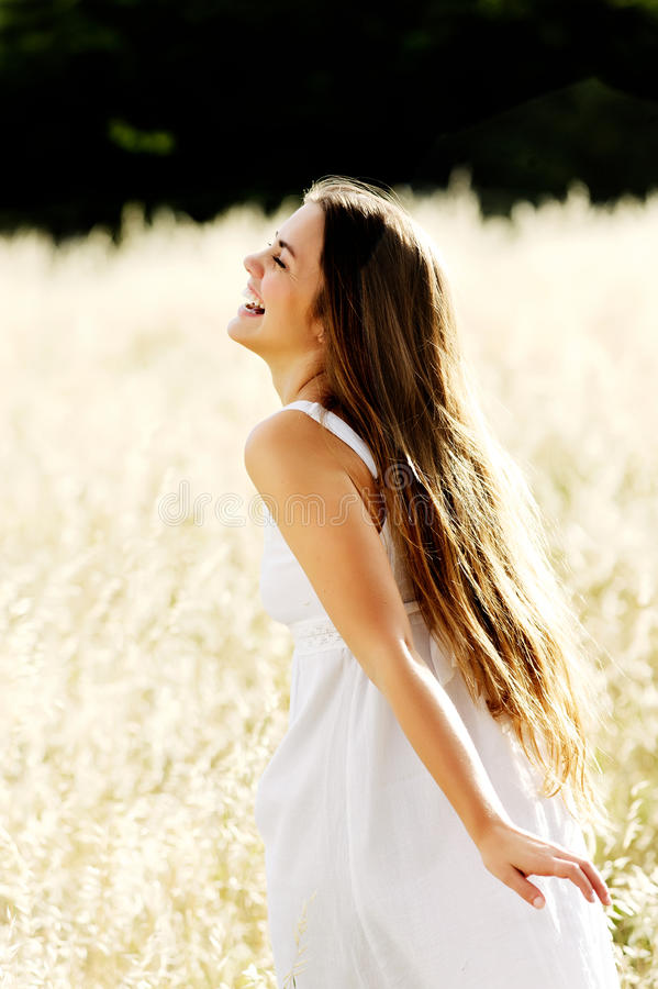 Beautiful woman outdoors on a sunny day stock photography