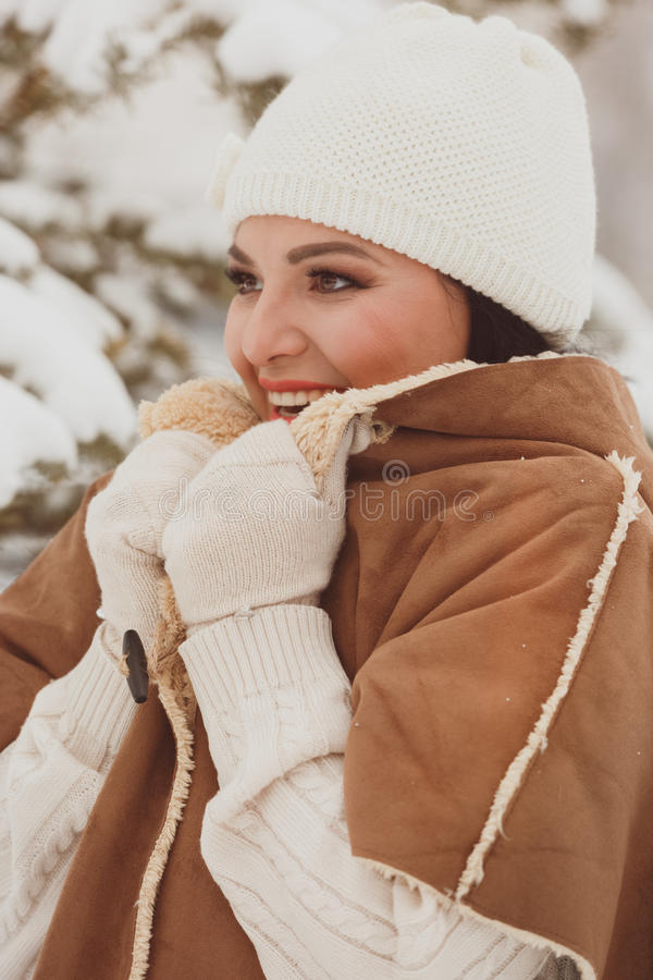 Beautiful woman outside in winter time, looking forward royalty free stock images