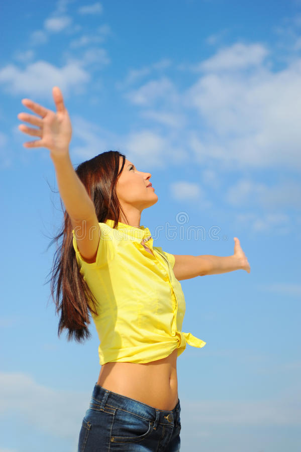 Beautiful Woman over blue Sky royalty free stock photo
