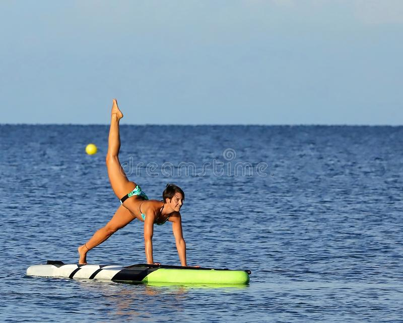 Beautiful woman on a paddle board royalty free stock photos