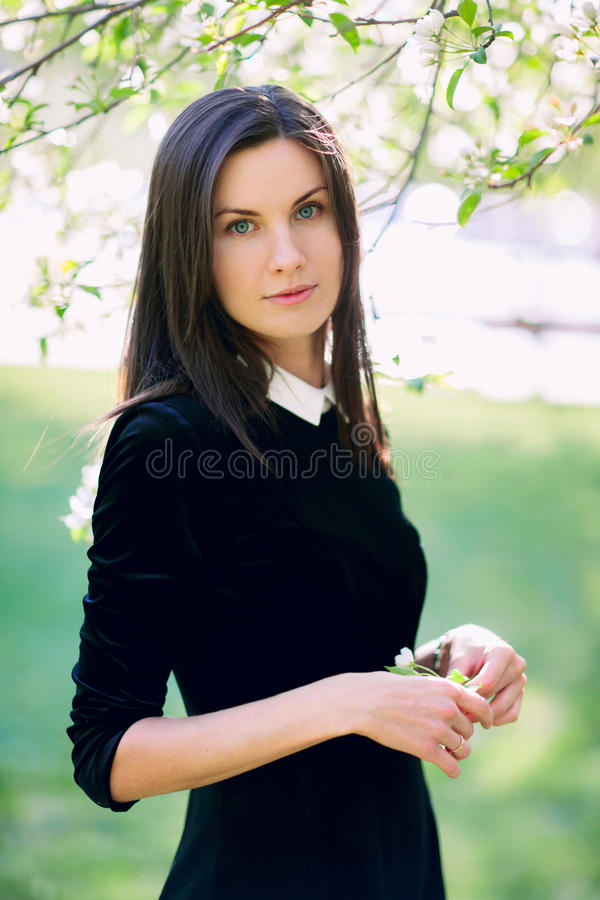 Beautiful woman in the park stock photo