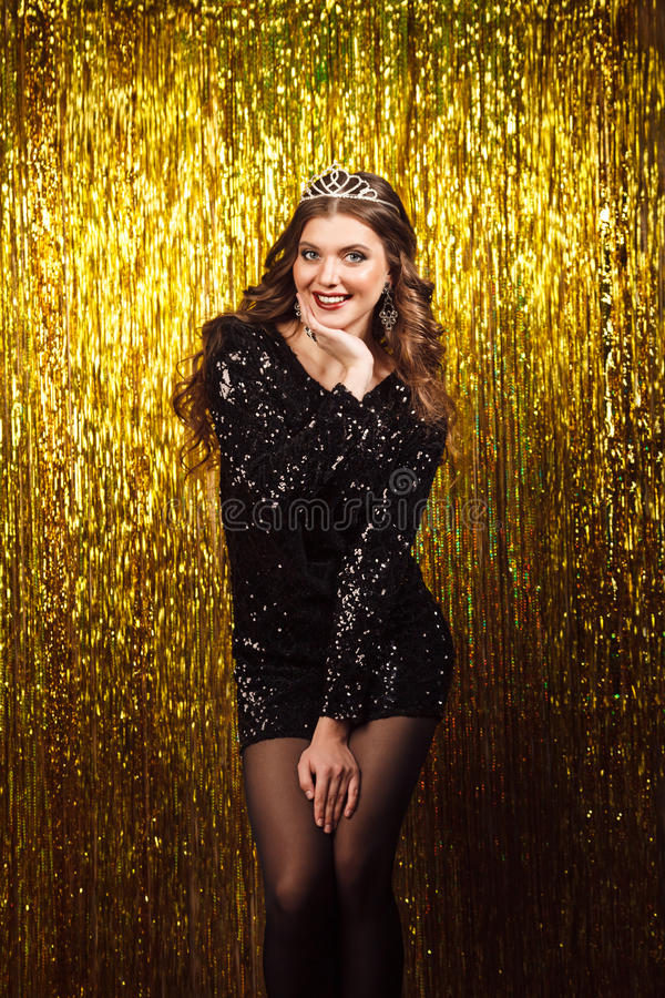 beautiful woman in party on sparkling background stock image