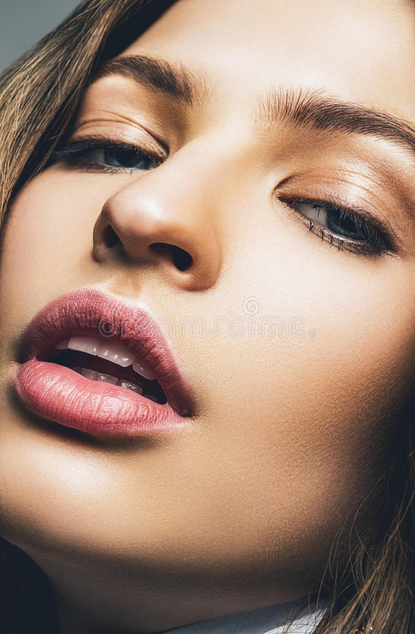 Beautiful woman with passionate pink lips royalty free stock image