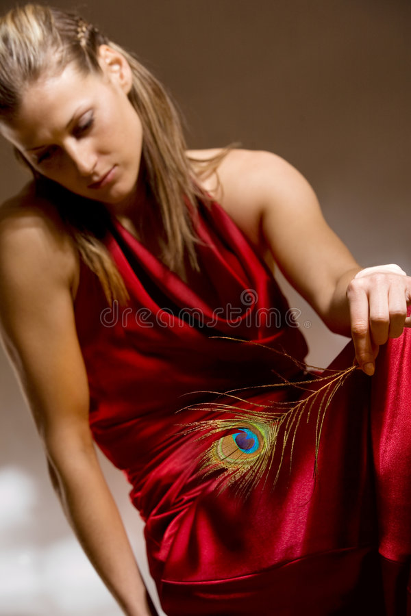 Download Beautiful Woman With Peacock Feather In Hand Stock Image - Image: 6943105