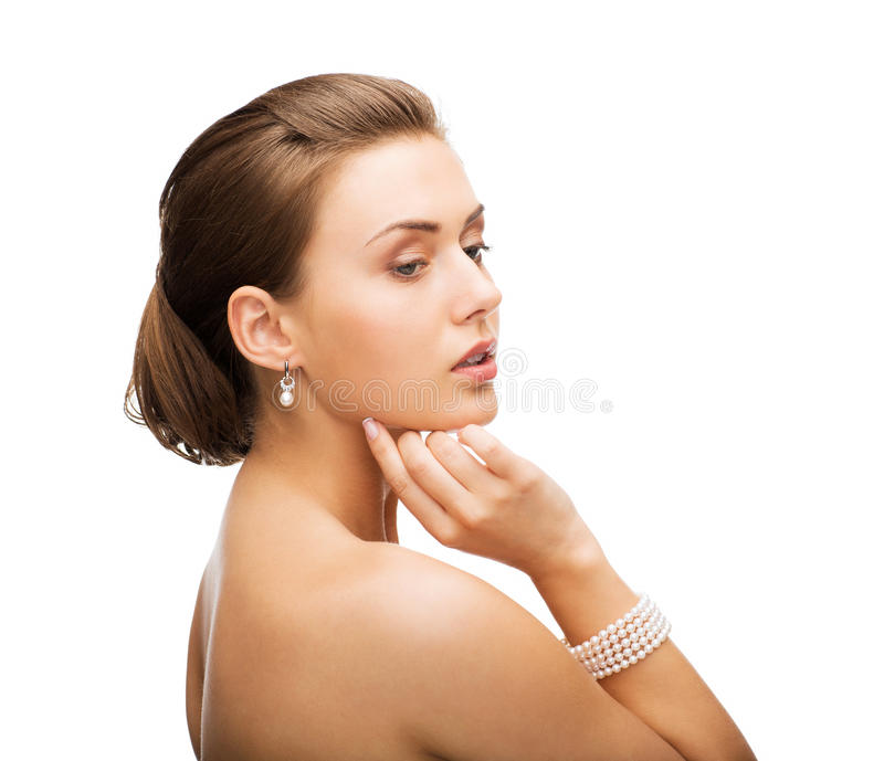 Beautiful Woman With Pearl Earrings And Bracelet Stock Photos