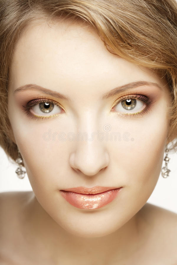 Beautiful woman with perfect makeup. The image of a beautiful woman with perfect makeup stock photos