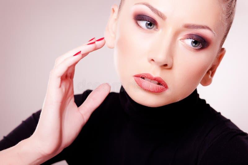 Beautiful woman with perfect skin wearing make-up. Studio stock photography