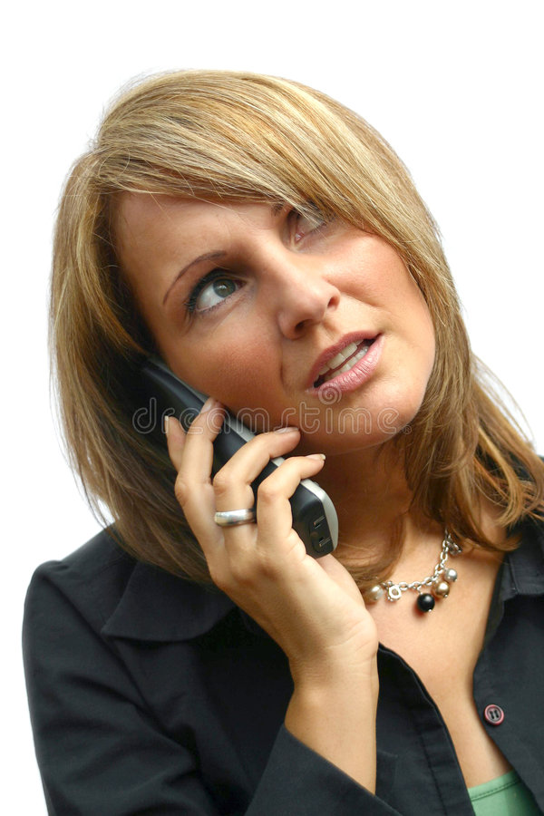 A beautiful Woman with phone. A beautiful Woman with a black phone stock image