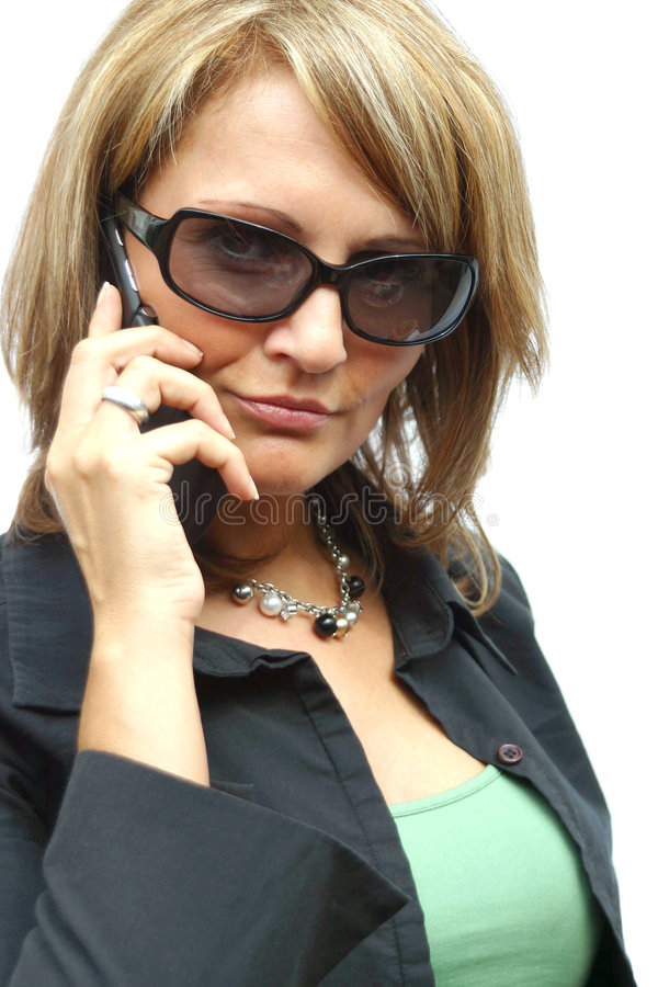 A beautiful Woman with phone. A beautiful Woman with a black phone royalty free stock photos