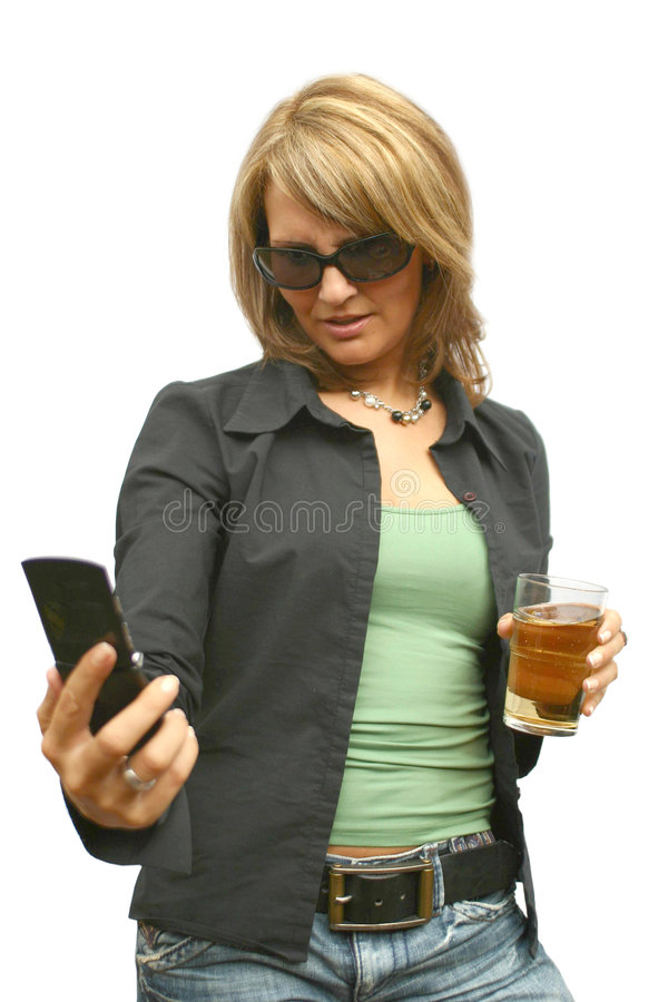 A beautiful Woman with phone. A beautiful Woman with a mobile phone and an glass stock photos