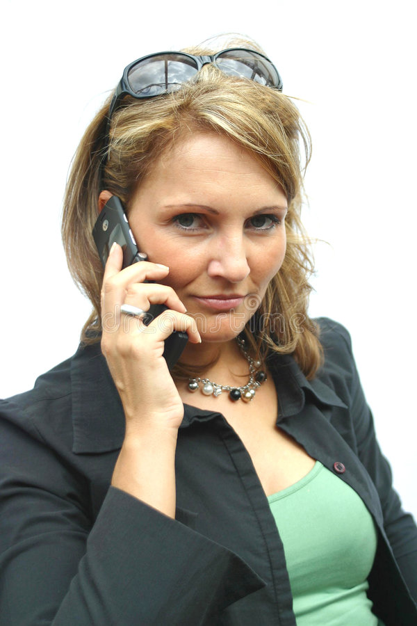 A beautiful Woman with phone. A beautiful Woman with a mobile phone royalty free stock photo