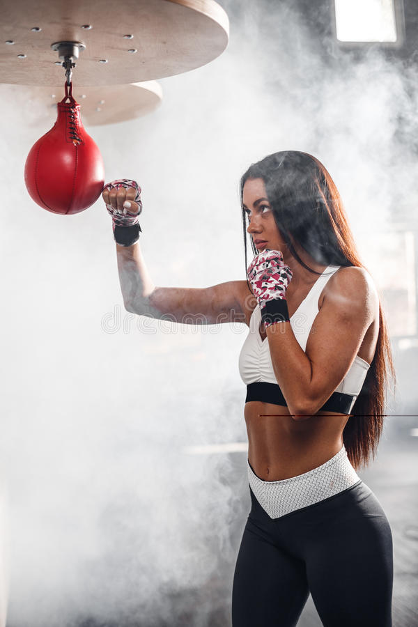 Beautiful woman with the pink boxing wraps stock image