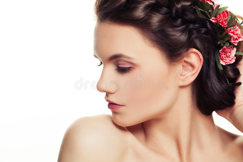 Beautiful Woman with Pink Flowers in Hairstyle royalty free stock photo