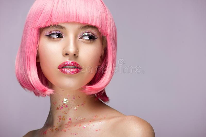 beautiful woman with pink hair and makeup with glitter looking away royalty free stock photos