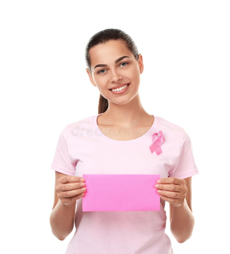 Beautiful woman with pink ribbon holding card on white background. Breast cancer concept royalty free stock images
