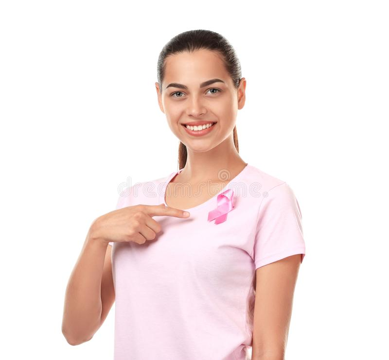 Beautiful woman with pink ribbon on white background. Breast cancer concept stock image