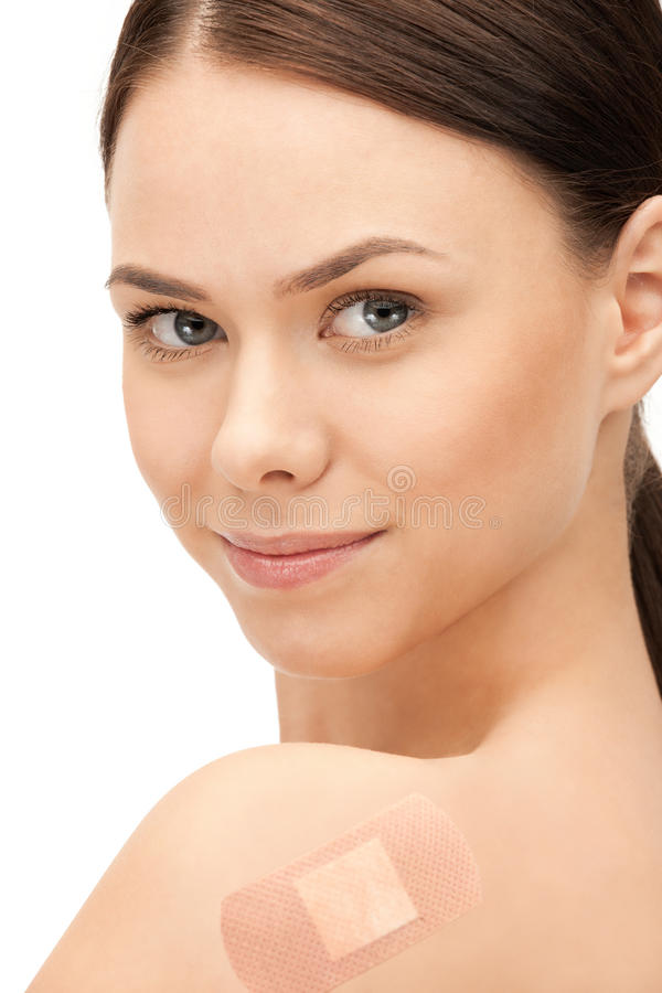 Beautiful woman with plaster royalty free stock photos