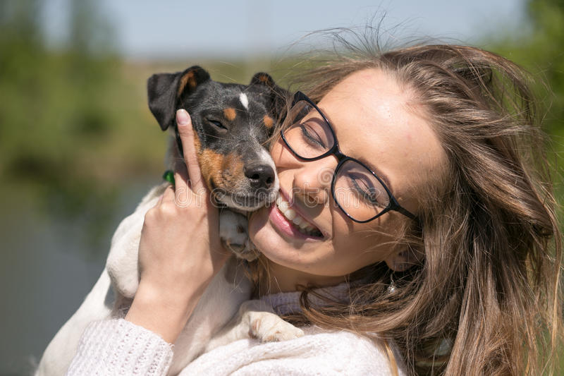 Beautiful woman playing with her dog. Outdoor portrait. series stock photography