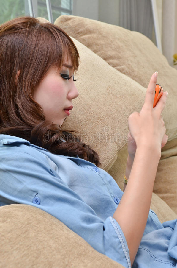 Download Beautiful Woman Playing With Her Mobild Phone Stock Photo - Image: 25559740