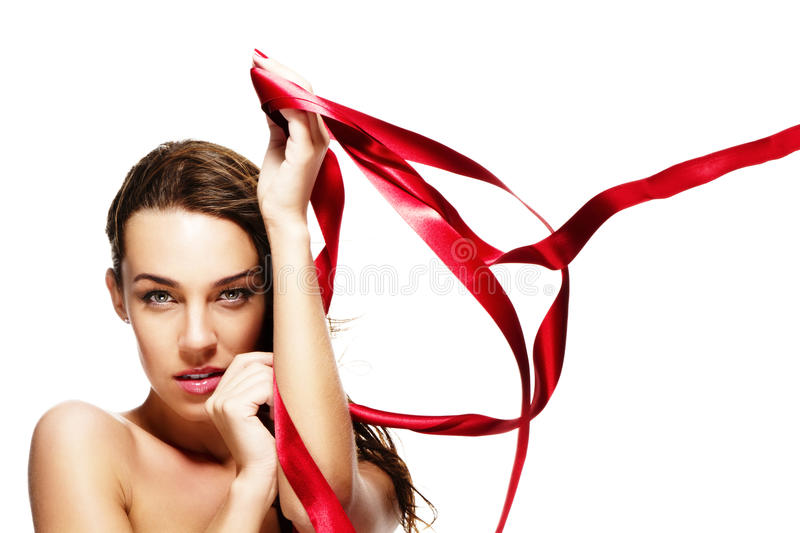 Beautiful woman playing with a red ribbon stock photos