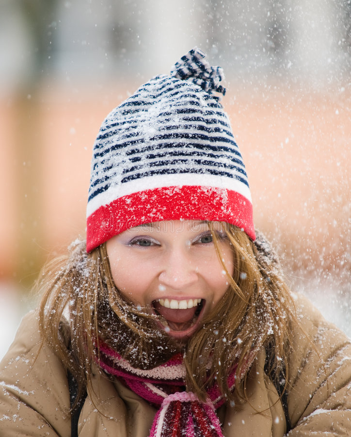 Beautiful woman playing with snow stock image