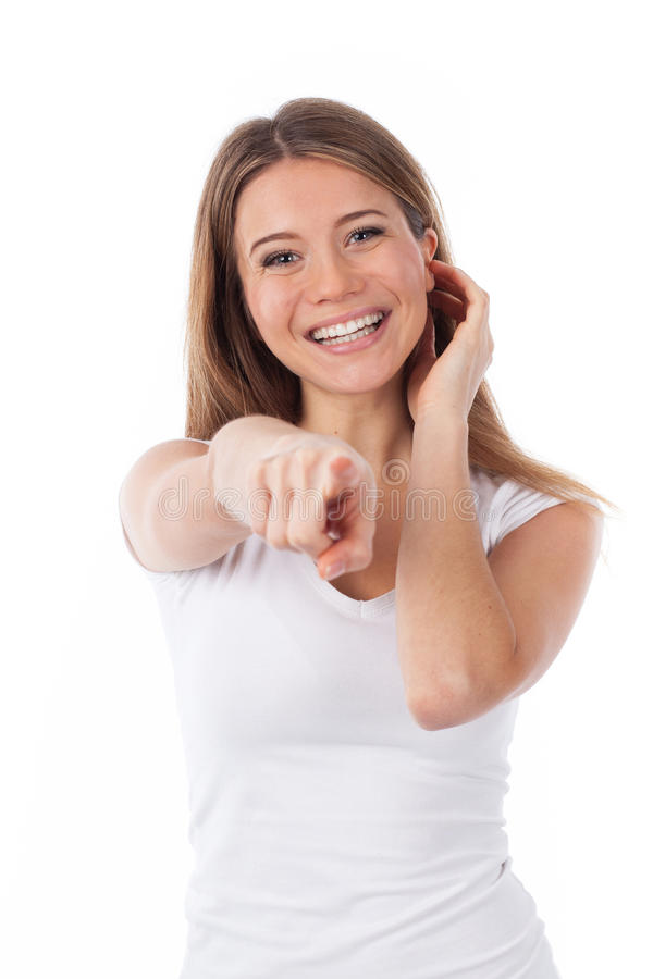 Beautiful woman pointing to the front royalty free stock photography
