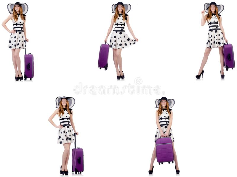 Beautiful woman in polka dot dress with suitcase isolated on whi royalty free stock images