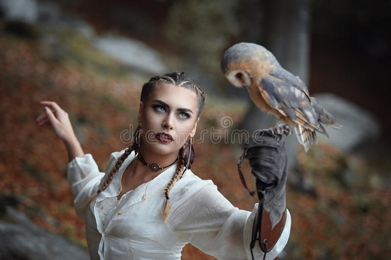 Beautiful woman portrait with barn owl. Outdoor shot stock photography