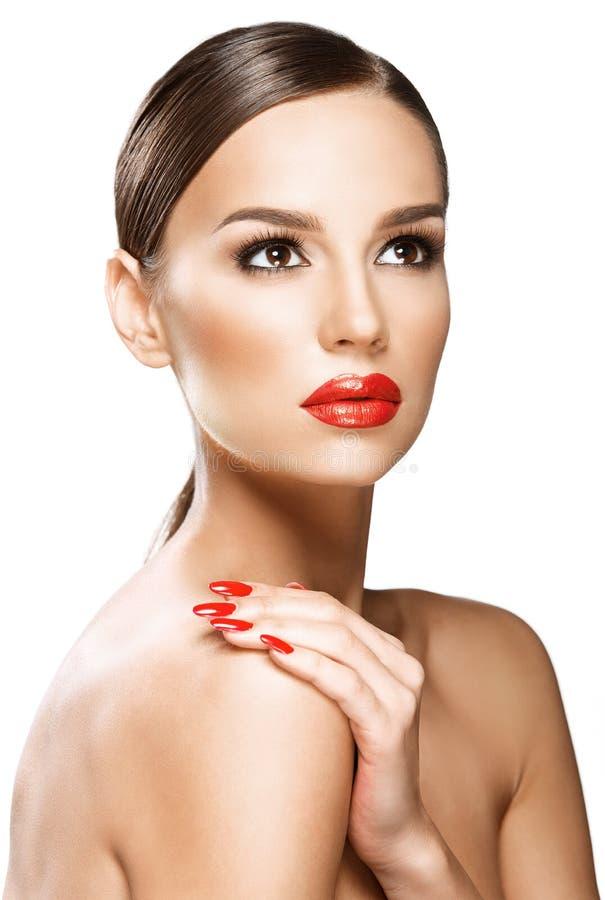 Beautiful woman portrait, beauty on white background. Red lips royalty free stock photo