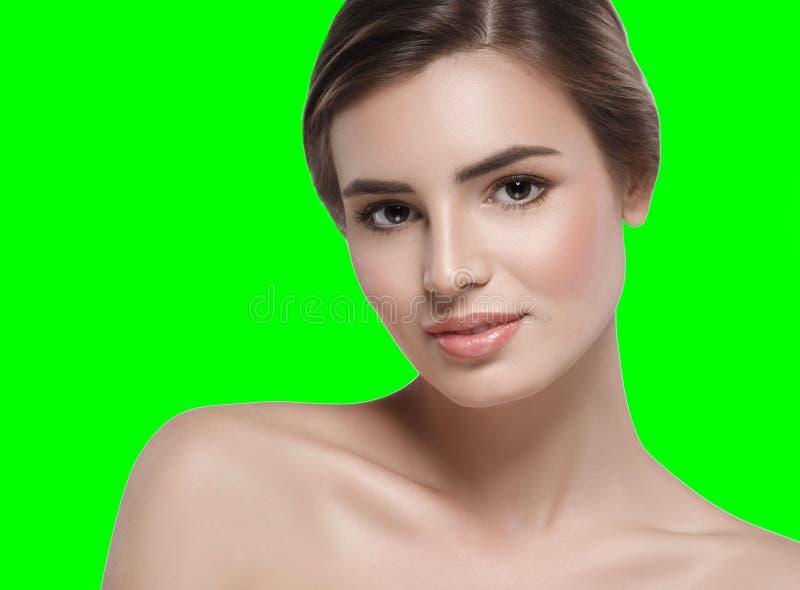 Beautiful woman portrait face chroma key green background. Studio shot stock image