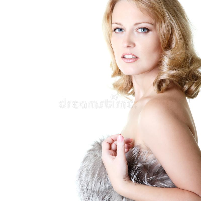 Beautiful woman portrait in furs, mid adult female face and shou royalty free stock photo