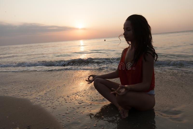 Beautiful Woman Portrait. Gorgeous young woman enjoying the quality time with herself at the seaside and beach surroundings royalty free stock photo
